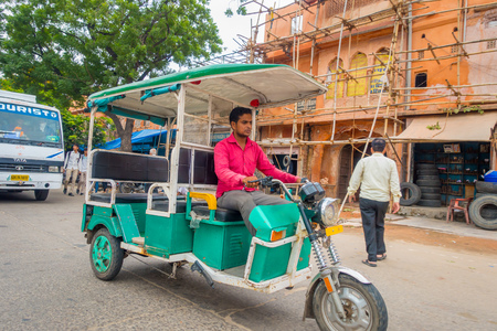 DELHI, INDIA - SEPTEMBER 19, 2017: Autorickshaw green in the street, paharganj. there are many tourist stay in this area in delhi in India