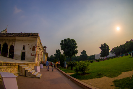 DELHI, INDIA - SEPTEMBER 25 2017: Unidentified people walking at outdoors of Inlaid marble, columns and arches, Hall of Private Audience or Diwan I Khas at the Lal Qila or Red Fort in Delhi, India, fish eye effect