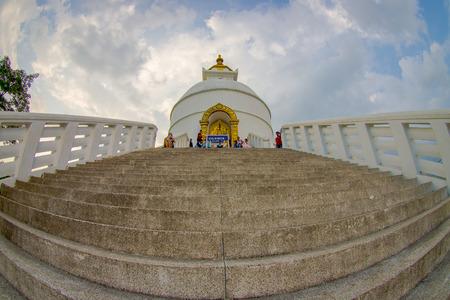 POKHARA, NEPAL, SEPTEMBER 04, 2017: Balanced on a narrow ridge high above Phewa Tal, the brilliant-white World Peace Pagoda in Pokhara is a massive Buddhist stupa. Editorial