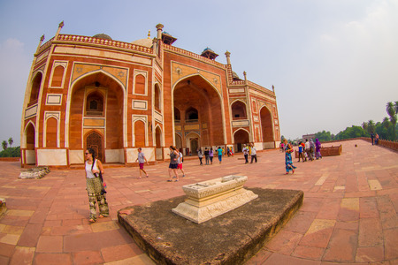 DELHI, INDIA - SEPTEMBER 19, 2017: Unidentified people walking in front of Humayun s Tomb, Delhi, India. UNESCO World Heritage Site, it is the tomb of the Mughal Emperor Humayun, fish eye effect