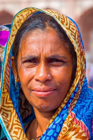 Jaipur, India - September 19, 2017: Portrait of an unidentified Indian woman with a blue with yellow hiyab, on the streets of Jaipur, India Editorial