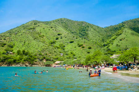 TAGANGA, COLOMBIA - OCTOBER 19, 2017: Unidentified tourists at the beautiful caribbean beach during a beautiful sunny day in Taganga, Colombia Editorial