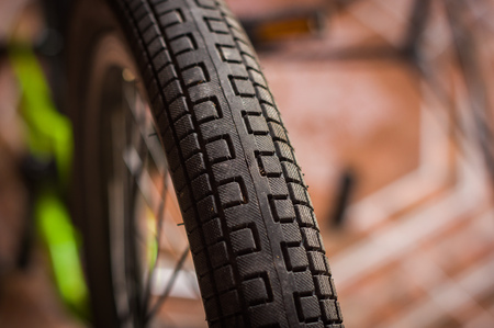 Close up of selective focus of the wheel of the bike in a workshop