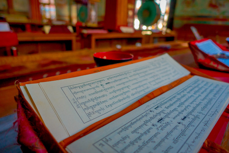 POKHARA, NEPAL - OCTOBER 06 2017: Indoor view of some prayer papers inside the building in Thrangu Tashi Choling Monastery in Kathmandu, Nepal Editorial