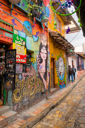 BOGOTA, COLOMBIA OCTOBER 22, 2017: Wall covered by graffiti in the La Candelaria neighborhood of Bogota, capital of Colombia