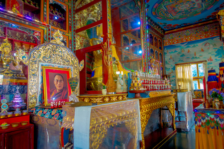 POKHARA, NEPAL - OCTOBER 06 2017: Indoor view of the sanctuary with some oblations in Thrangu Tashi Choling Monastery in Kathmandu, Nepal