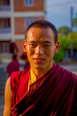 POKHARA, NEPAL - OCTOBER 06 2017: Portrit of young buddhist monk at outdoors at the Tashi refugee settlement in Pokhara, Nepal