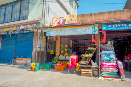 POKHARA, NEPAL - OCTOBER 06 2017: Outdoor view of a food market with a pavement street, located in Pokhara, Nepal