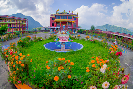 POKHARA, NEPAL - OCTOBER 06 2017: Aerial view of Tibet architecture. Sakya monastery is a pilgrim and tourist destination. Its religious structure is influenced by Mongol style, fish eye effect Foto de archivo - 91222938