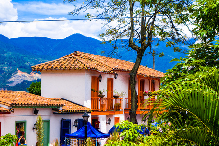Facade view of clay rooftops with some colorful buildings in Pueblito Paisa in Nutibara Hill, reproduction of the traditional Colombian township in Medellin city 写真素材