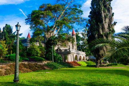 Beautiful outdoor view of the garden with a gorgeous view of gothic medieval Castle Museum behind in Medellin, Colombia, South America Stock Photo