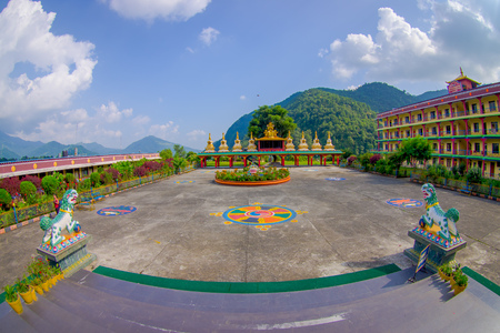POKHARA, NEPAL - OCTOBER 06 2017: Outdoor view of Tibet architecture. Sakya monastery is a pilgrim and tourist destination. Its religious structure is influenced by Mongol style, fish eye effect Foto de archivo - 92693390
