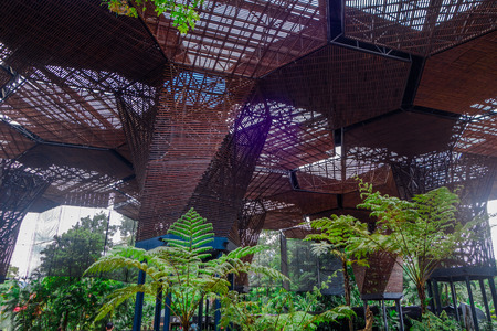 Beautiful architectural woodden structure in a botanical greenhouse in Medellin