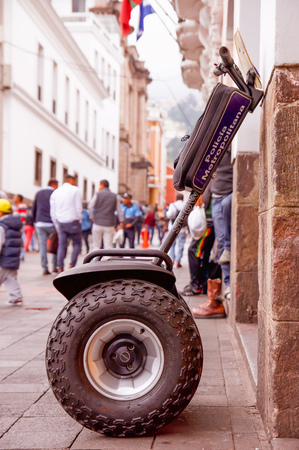 Quito, Ecuador - November 28, 2017: Outdor view of a policemn segwey parket in a sidelwalk in the city of Quito, during city patrol duty