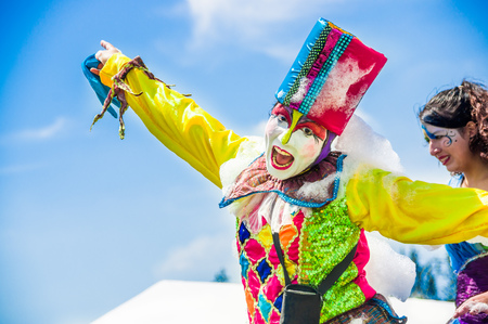 QUITO, ECUADOR- NOVEMBER, 28, 2017: Close up of unidentified happy man wearing a clown costume at a foam party at Quito festival Editorial