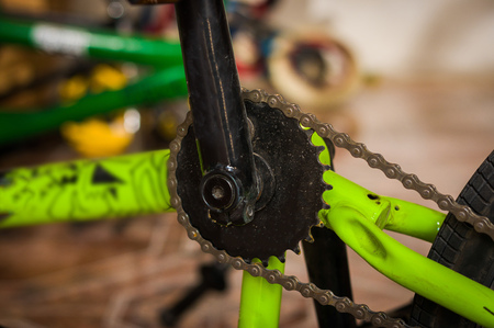 Close up of bicycle pedal fixed by a mechanic in a workshop