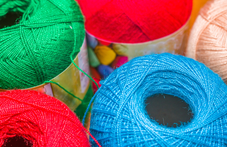 Close up of colorful wool yarn balls in a blurred background