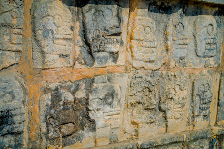 Close up of carved forms in the rock the enter of the Chichen Itza, one of the most visited archaeological sites in Mexico
