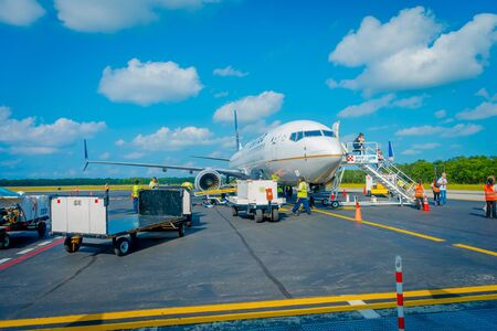 COZUMEL, MEXICO - NOVEMBER 12, 2017: Unidentified people landing from the airplane on the runway of Cozumel International Airport in Mexico Editorial
