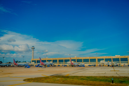CANCUN, MEXICO - NOVEMBER 12, 2017: Outdoor view of Airplanes on the runway of Cancun International Airport in Mexico. Airport is located on the Caribbean coast of Yucatan Peninsula, its second busiest airport in Mexico