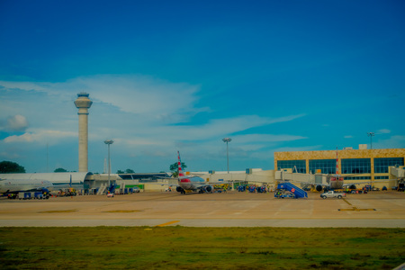 CANCUN, MEXICO - NOVEMBER 12, 2017: Beautiful outdoor view of Airplanes on the runway of Cancun International Airport in Mexico. Airport is located on the Caribbean coast of Yucatan Peninsula, its second busiest airport in Mexico