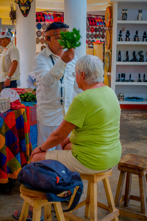 CHICHEN ITZA, MEXICO - NOVEMBER 12, 2017: Indoor view of Indian chaman using plants to cure sick people inside of a store in Mexico