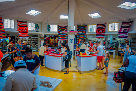 CHICHEN ITZA, MEXICO - NOVEMBER 12, 2017: Indoor view of unidentified people buying inside of a souvenir store, beautiful and Mayan handicrafts