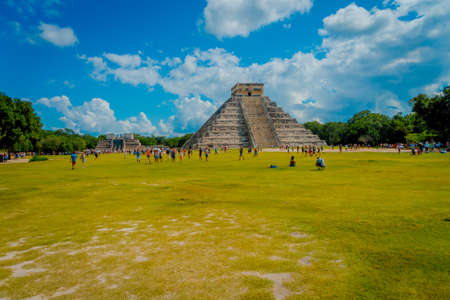 CHICHEN ITZA, MEXICO - NOVEMBER 12, 2017: Unidentified of tourists visiting Chichen Itza, one of the new 7 wonders of the world thanks to the votes of millions of people worldwide on August 15, 2012 in Chichen Itza, Mexico