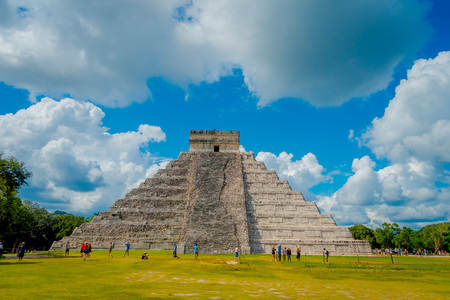 CHICHEN ITZA, MEXICO - NOVEMBER 12, 2017: Unidentified tourists visiting Chichen Itza, one of the new 7 wonders of the world thanks to the votes of millions of people worldwide on August 15, 2012 in Chichen Itza, Mexico