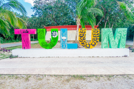 TULUM, MEXICO - JANUARY 10, 2018: Outdoor view of huge colorful letters of Tulum at the enter of Mayan Ruins of Tulum in Meixco