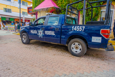 Playa del Carmen, Mexico - January 10, 2018: View of a blue police van parked at outdoors in 5th Avenue, the main street of the city. The city boasts a wide array of tourist activities due to its geographical location in the Riviera Maya