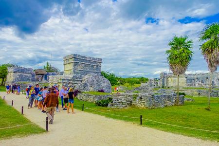 TULUM, MEXICO - JANUARY 10, 2018: Unidentified people walking in Mayan Ruins of Tulum Besides Caribbean Sea. Riviera Maya, Traveling America Editorial
