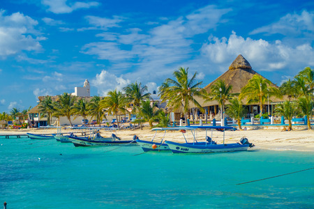 Puerto Morelos, Mexico - January 10, 2018: Outdoor view of many boats in a row in the water in Puerto Morelos beach Mexico