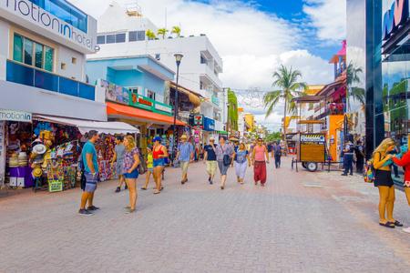 PLAYA DEL CARMEN, MEXICO - JANUARY 10, 2017: Crowd of tourists along city streets. Approximately 2 million tourists per year visit Playa del Carmen and its surroundings