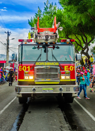 Quito, Ecuador - January 31, 2018: Beautiful outdoor view of a fire truck circuling in the streetss during a parade in the city of Quito, Ecuador