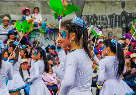 Quito, Ecuador - January 31, 2018: Group of young school students girls wearing uniform for the parade in Quito Festivities