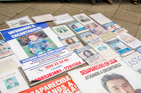 QUITO, ECUADOR, JANUARY 11, 2018: Close up of newspaper with a detailed information of reward and information of missed year, located in the plaza grande in the city of Quito