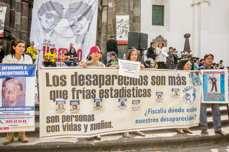QUITO, ECUADOR, JANUARY 11, 2018: Unidentified people holding a huge banners during a protest in the plaza grande in the city of Quito, demanding for an explanation of their relatives missing
