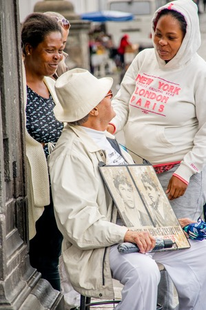 QUITO, ECUADOR, JANUARY 11, 2018: Unidentified people talking with the father of the Restrepo brothers missed 30 years ago in the city of Quito, Ecuador