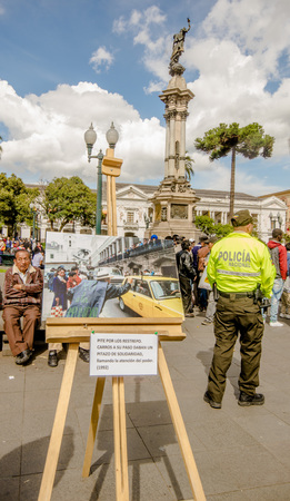QUITO, ECUADOR, JANUARY 11, 2018: Close up of photographies over a wooden structure at outdoors in plaza grande with unidentified people during a protest in the city of Quito, demanding for an explanation of their relatives missing
