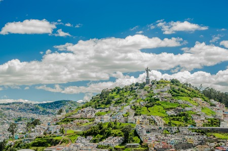 QUITO, ECUADOR, FEBRUARY 02, 2018: High view of the city of Quito and some buildings, with Panecillo hill in the top of the mountain