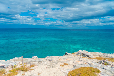Beautiful outdoor view on the edge of the cliff Isla Mujeres Punta sun caribbean sea, with a turquoise water in Mexico