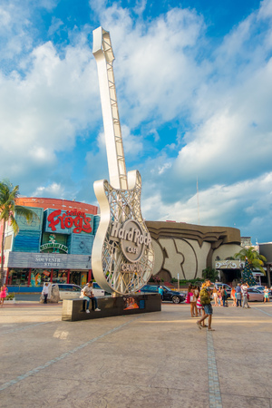 CANCUN, MEXICO - JANUARY 10, 2018: Unidentified people at outdoors next to Hard Rock Cafe metallic guitar structure in Cancun at the Forum center in Cancuns hotel zone