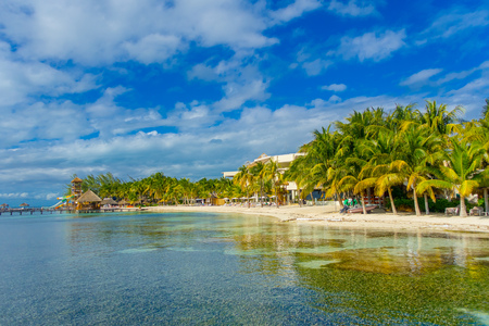 Astonishing beach with transparent water and white sand in the coasts of Isla mujeres in caribbean Beach in Mexico, paradise island, sun and palms. Tourism concept Stock Photo
