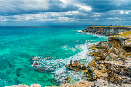 Beautiful view of rocky cliff and turquoise water at sunrise on the the southern part of the Isla Mujeres in Caribbean, Mexico