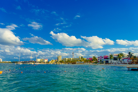 Outdoor view of some buildings in the horizont at the beach Isla Mujeres, with blue water in Mexico Stock Photo