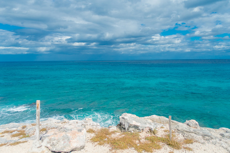 Beautiful outdoor view on the edge of the cliff Isla Mujeres Punta sun caribbean sea, with a turquoise water and gorgeous sunny day in Mexico Stock Photo