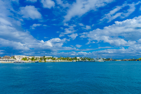 ISLA MUJERES, MEXICO, JANUARY 10, 2018: Beautiful outdoor view of military ship and some buildings in the horizont in the beach Isla Mujeres in caribbean sea, with a turquoise water in Mexico