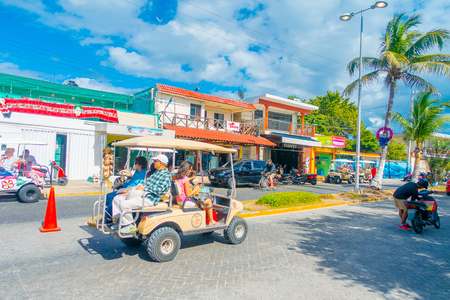 ISLA MUJERES, MEXICO, JANUARY 10, 2018: Unidentified people walking in the streets of Isla Mujeres surrounding of some buildings in Mexico