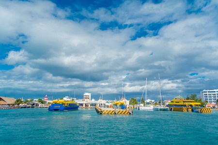 ISLA MUJERES, MEXICO, JANUARY 10, 2018: Beautiful outdoor view of unidentified people walking in the shore in Isla Mujeres with some boats, during a gorgeous day in Mexico Editorial
